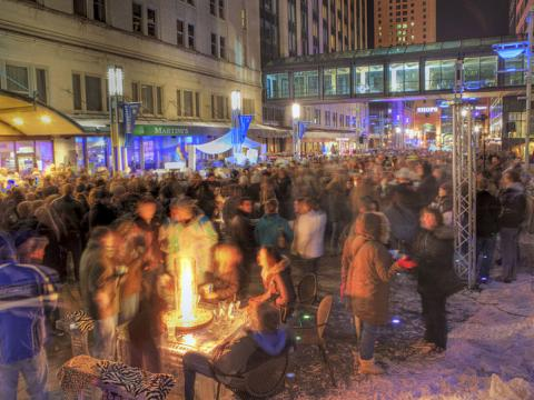 The crowd gathered for outdoor bar event SocialICE in Rochester