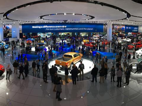 Browsing displays at the North American International Auto Show in Detroit