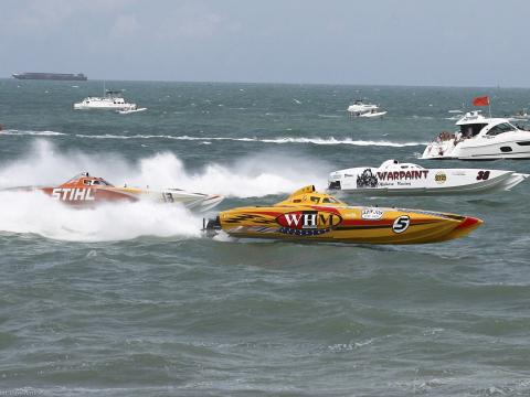 Super boats racing in the Atlantic Ocean during Thunder on Cocoa Beach in Florida